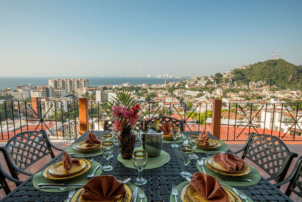 Enjoy 2 meals per day on the large terrace with incredible ocean and city views
