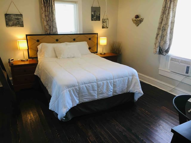 Master Bedroom always with fresh linens, and multiple pillows to chose from. USB plug in for chargers on both nightstands.