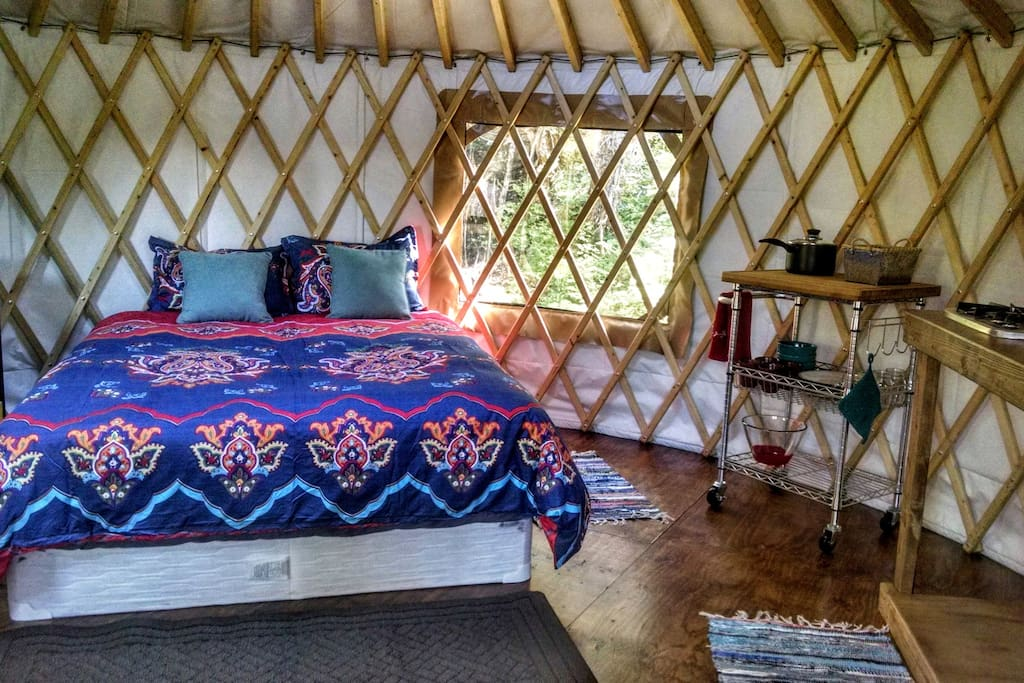 Sleep in the round and watch the stars through the yurt's skylight. Kitchenette to the right.