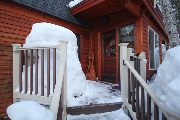 Front entry decorated in snow.