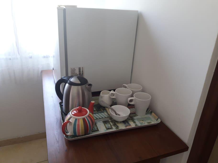 Coffee and tea making facilities with fridge.