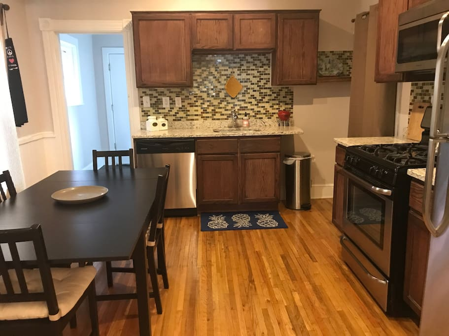 Kitchen with beautiful granite counter tops, tons of great cooking and baking supplies, dishwasher, and new appliances!