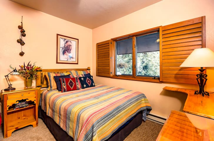 Second BR with Native American decor and postcard forest views of National Forest.