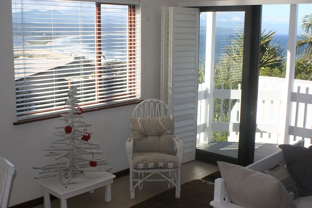 The sunny living area offers all round views from every window.