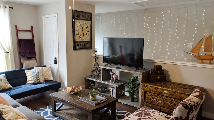"Very cozy living room with 55"" 4K UHD Roku TV"