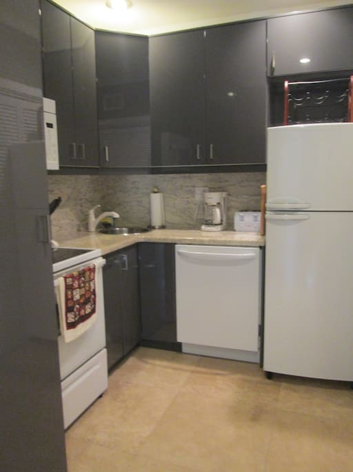 Kitchen w/ washer & dryer