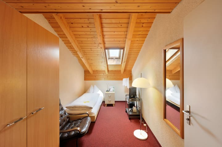 Room with shared bathroom and bookable amenities
