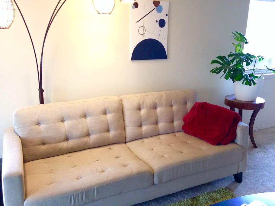 Tons of natural light, comfy mid century modern couch.