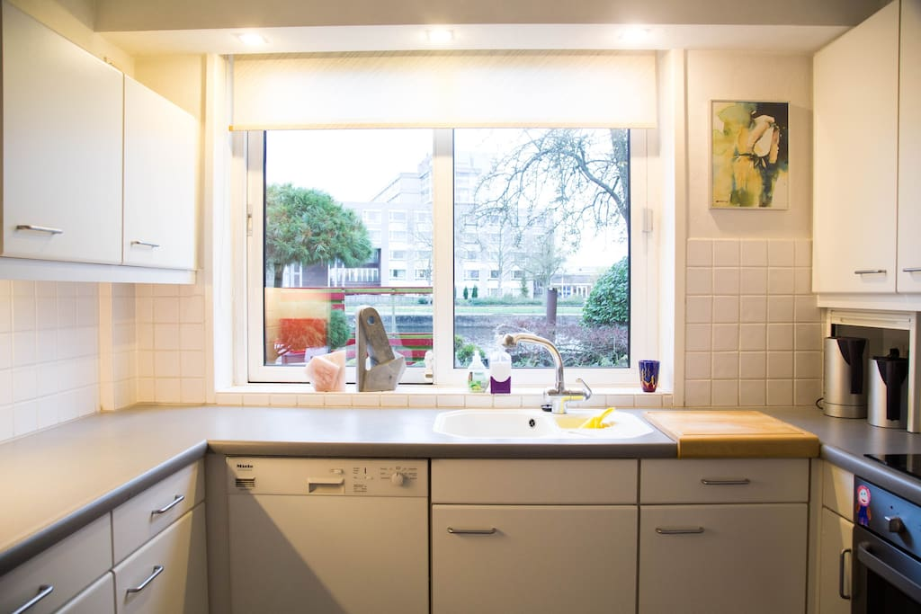 Fully equipped, luxury kitchen with view of garden