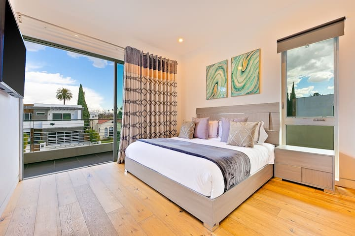 """Fifth Bedroom located upstairs on the second floor, King size bed with 2 night stand, Built in closet, In-suite Bathroom & balcony with 55"""" Smart TV"""
