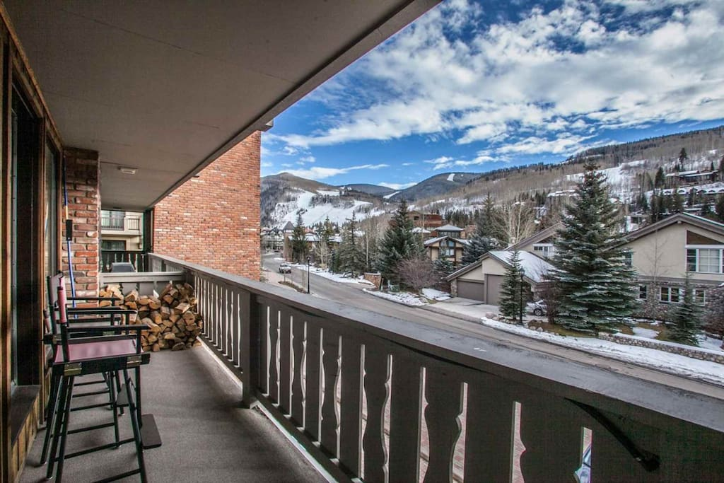 Front deck overlooks the mountain and has seating for 2 plus gas grill.