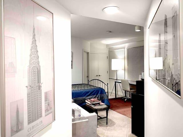 En-suite hallway entrance to bedroom and photo gallery.