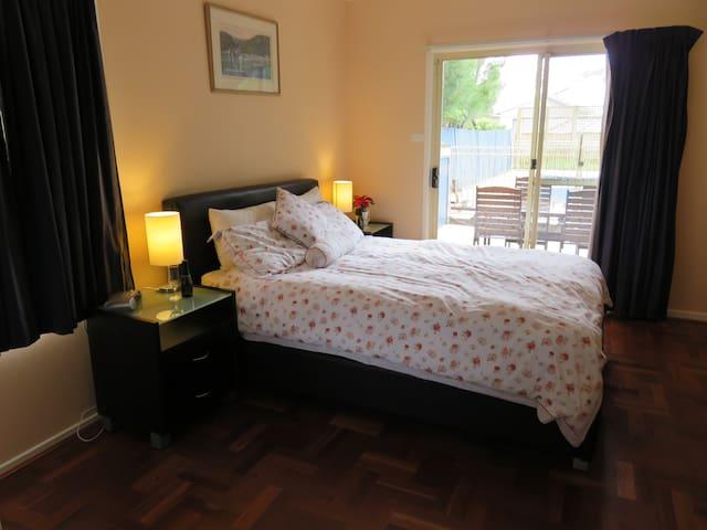 Spacious bedroom overlooking pool