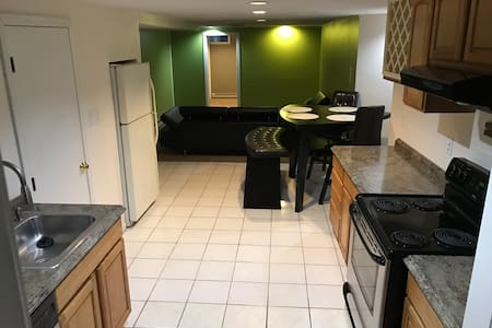 Basement with TV,  kitchen, laundry - Lynn - Apartment