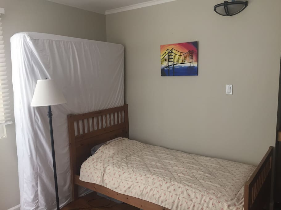Twin bed with extra queen mattress