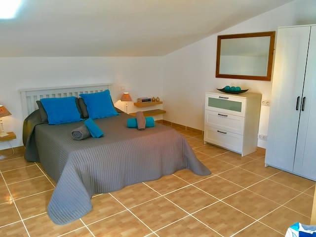 Open plan bedroom/sitting room under the eaves.