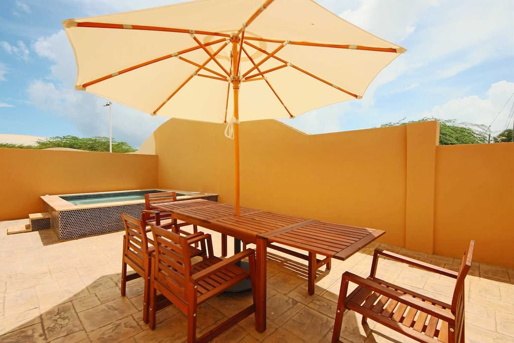 Your patio completed with a 6-seat outdoor dining table with outdoor umbrella!