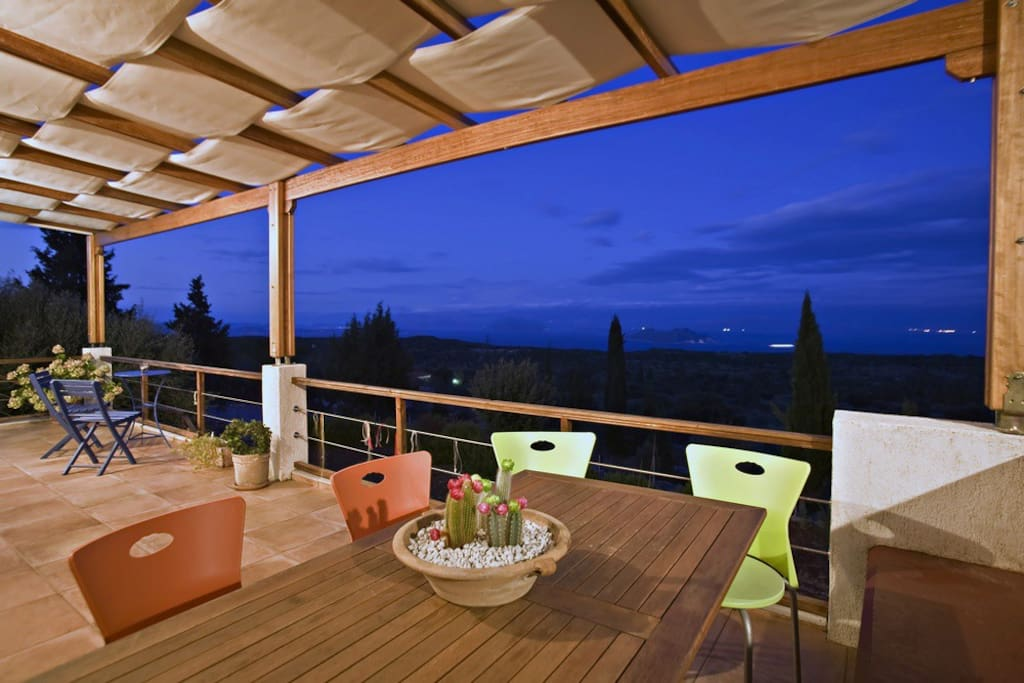 A spacious terrace with a view to the sea and Anogi plateau, complete silence but for the sound of crickets.