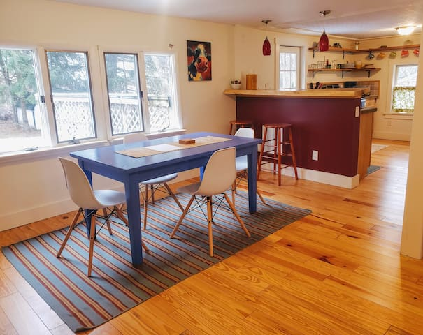 The bright and cheery dining room looks out onto the secluded backyard, making a great place for family breakfasts.