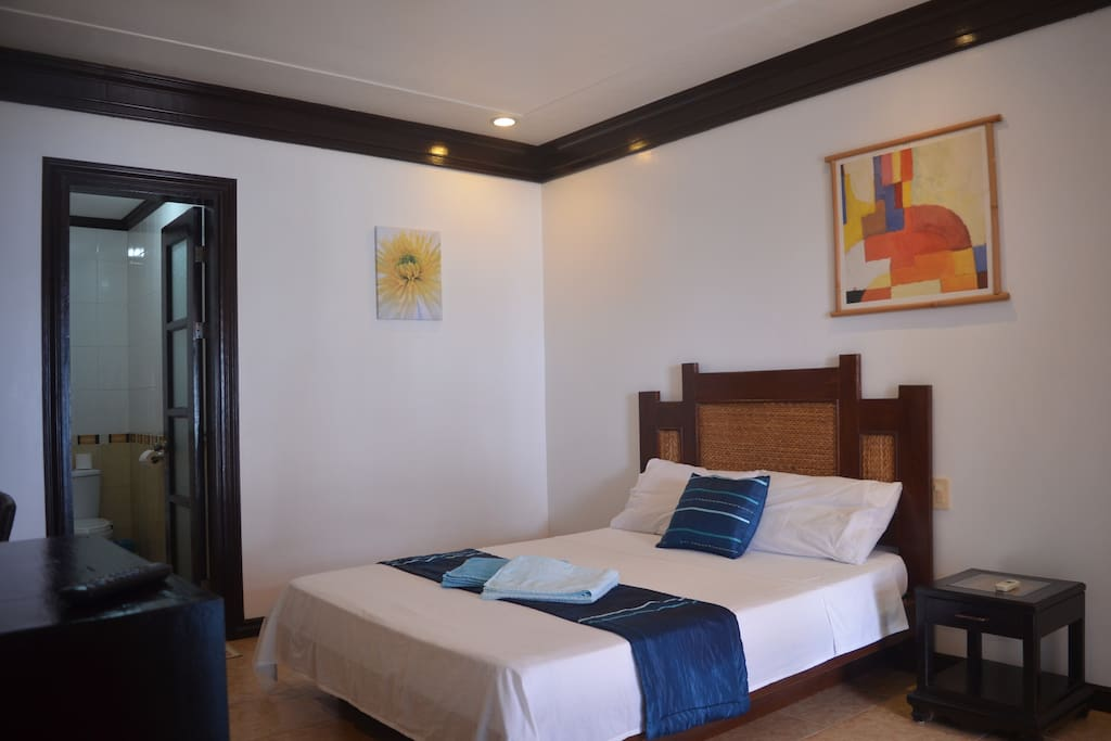 Superior Room furnished with a double bed