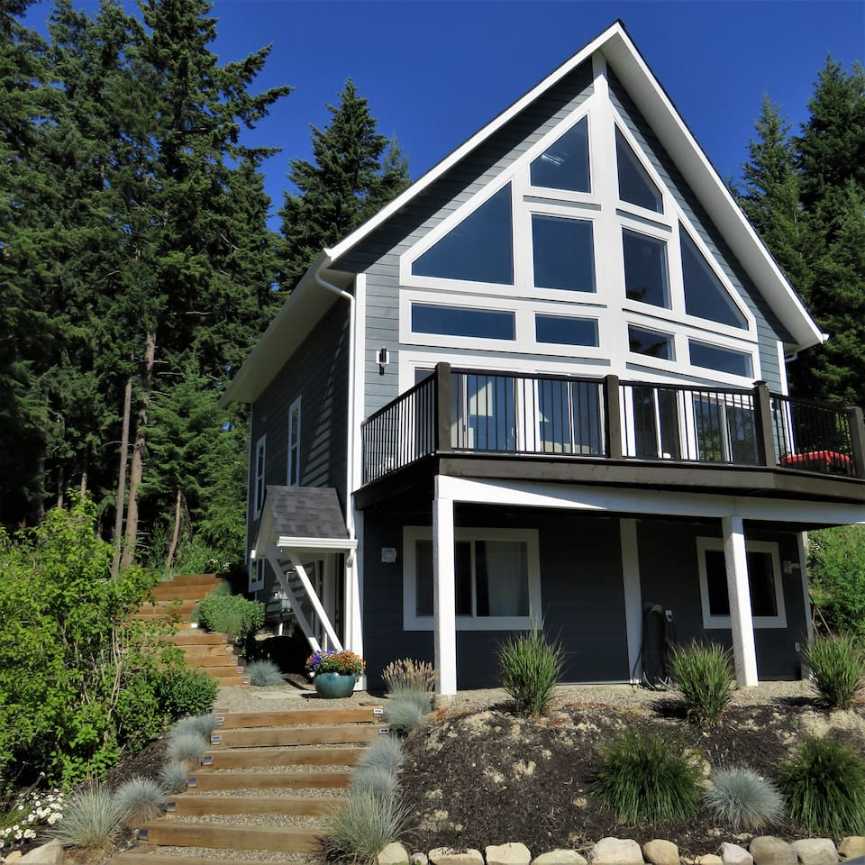 Juniper house is situated on a private lot with lake and mountain views.