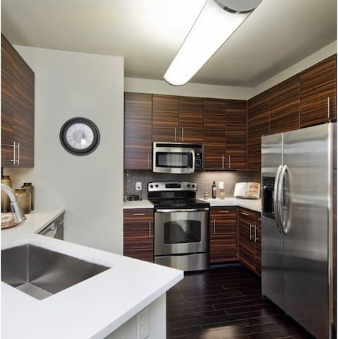Gourmet-style kitchen with energy efficient appliances and large countertops.