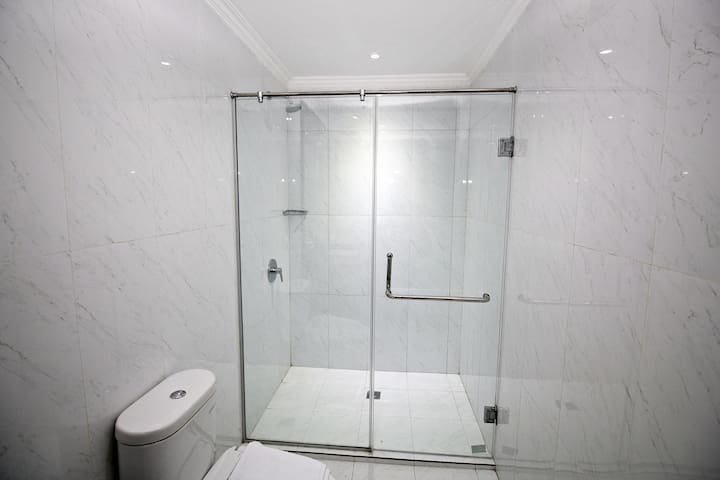 Private Toilet with Spacious Standing Shower