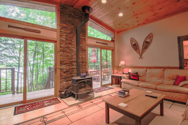 Spacious waterfront chalet w/ cozy wood stove, outdoor firepit, grill, & more!