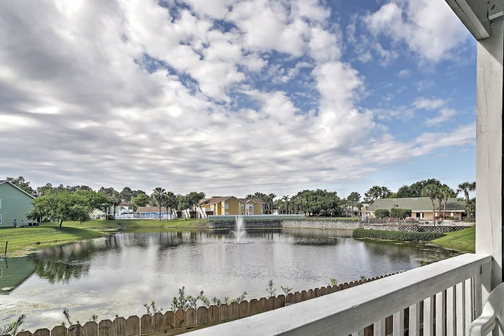 Relish in Florida's balmy weather from the private balcony the overlooks the community pond.