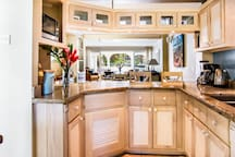 Well equipped kitchen that looks over dining & living room out to the water views