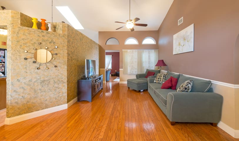 "Private guest living room area - entry view.  55"" 3D smart TV with all apps and Apple TV.  We also offer BlueRay DVD"