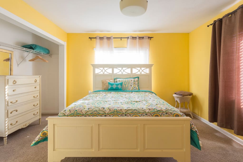 Master bedroom boasts a comfortable queen size bed.