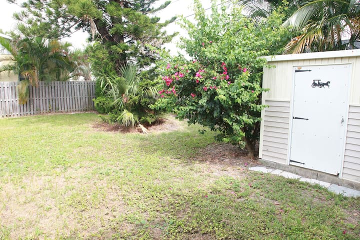 Fenced back yard and shed