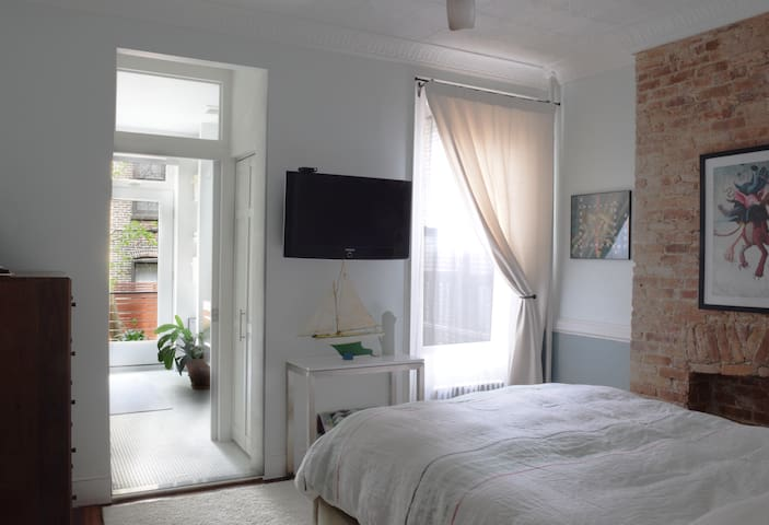 """The master bedroom has a queen size bed, a 40"""" TV and private access to the master bathroom."""