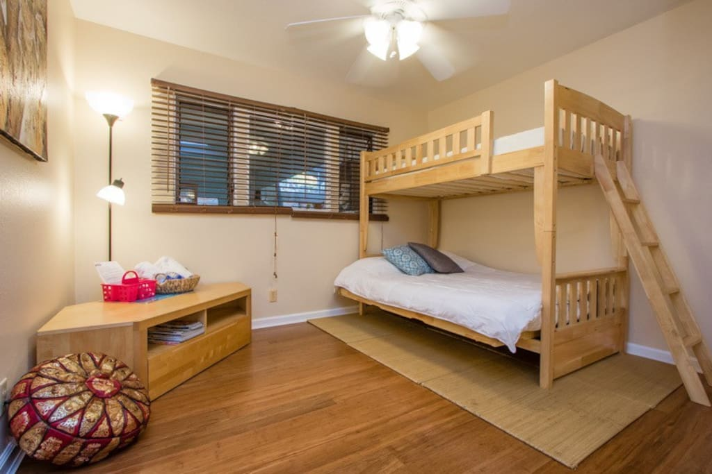 This is the Brown Room. It fits 3 adults comfortably as long as 2 adults don't mind sharing a full size bed. We can bring in a twin size air mattress, but it will be tight! Not recommended during the summer.