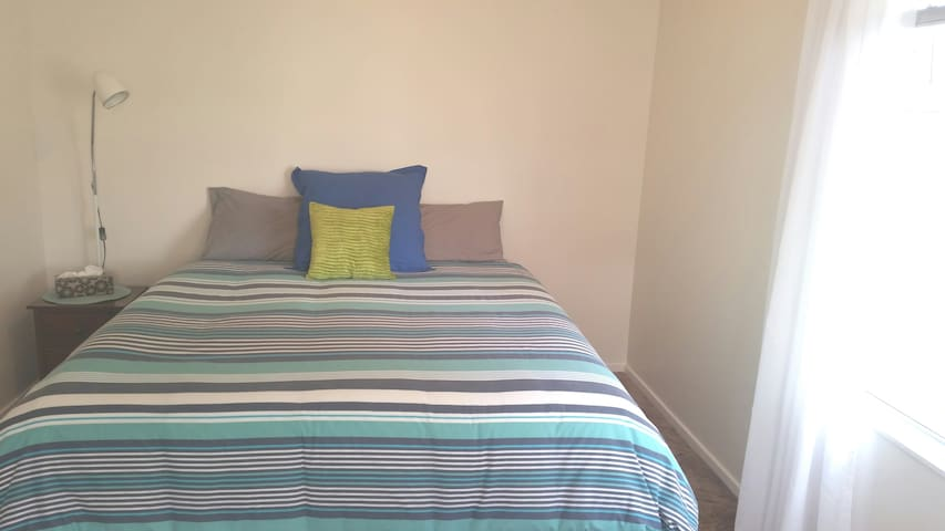 king size bed in large bedroom