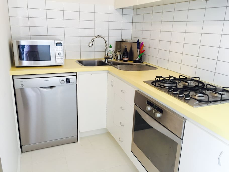 Complete kitchen with oven, gas stove, full fridge microwave and dishwasher