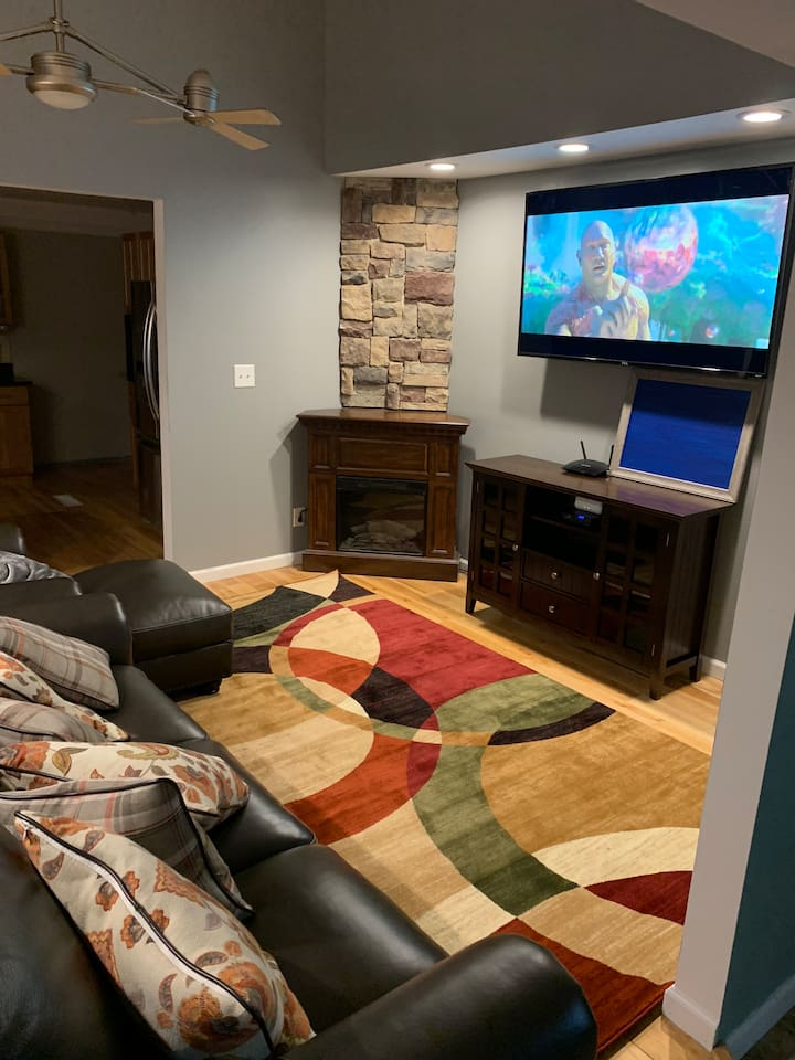 Comfy leather couch from which to watch Hulu, Netflix ,HBO and Sling TV on a 65 inch 4K television.