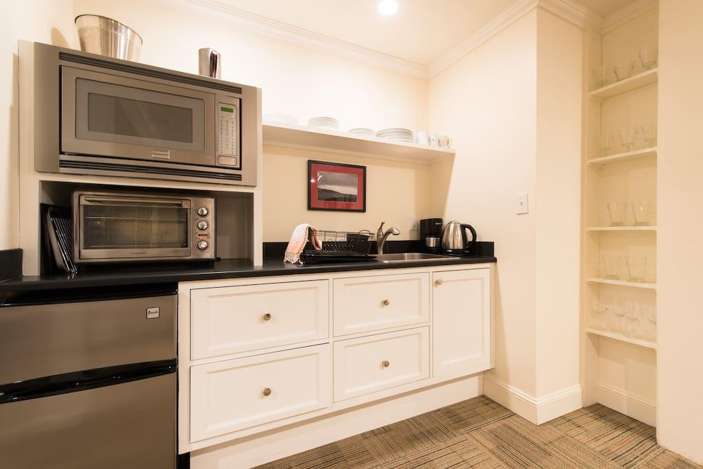 Kitchenette has new appliances: large microwave, toaster-oven, sink, mini-fridge & freezer
