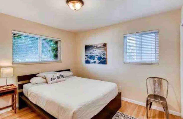 Master bedroom upstairs with a pillow top mattress and an attached newly remodeled bathroom.