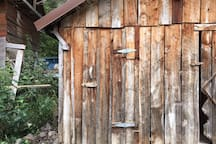 Ole' time outhouse beside the Brown Bear!
