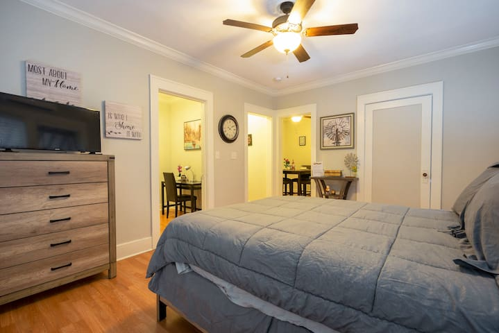 Queen size plush bed with an LCD Smart TV. This bedroom flows into the kitchen and dining area.