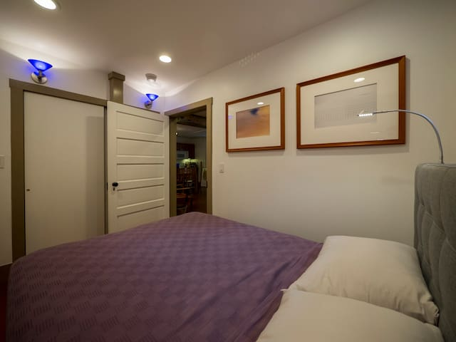 Bedroom includes a large closet with plenty of drawers, shelves and room for hanging