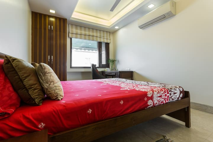 Sunny south delhi studio with high speed WiFi & AC