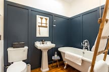 Panelled bathroom with luxury toiletries