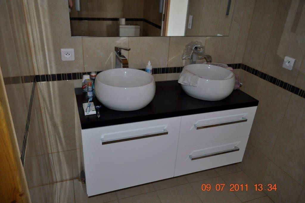 En suite bathroom/shower with twin sinks