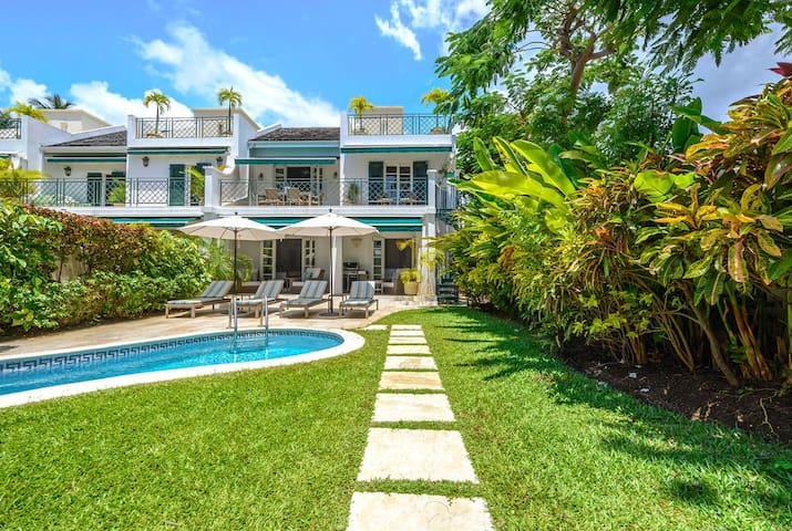 Footsteps Mullins Bay across from beach with pool