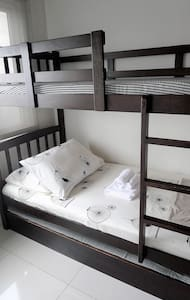 Clean and Affordable Condo Unit with Free WIFI - Quezon City - Íbúð