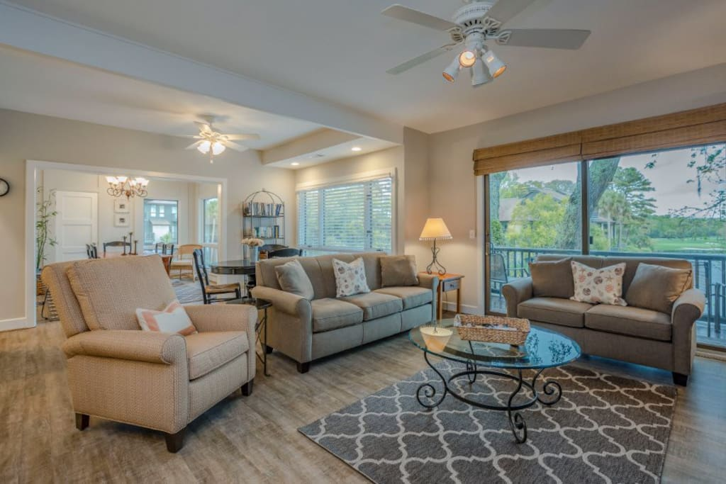 Great room with new furniture and flooring with sliding doors on to private deck