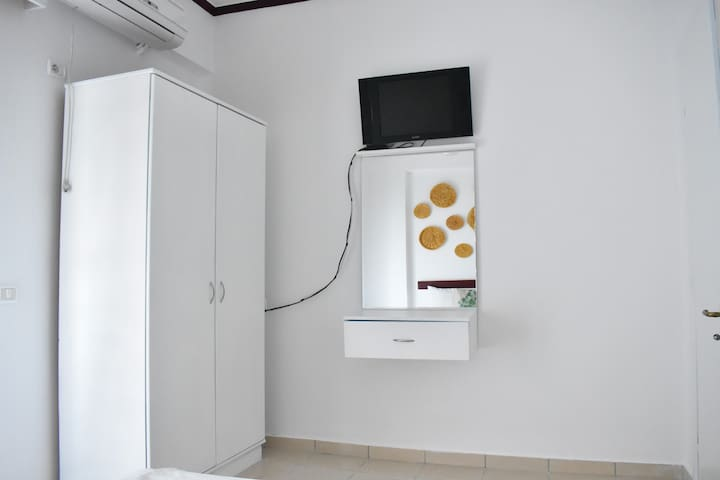 the bedroom includes tv, air-conditioner,mirror and closet